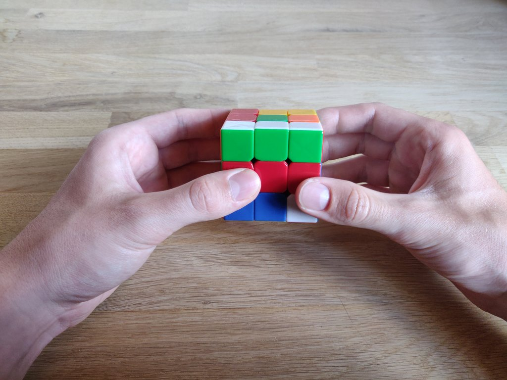 Rotiere den Würfel um seine eigene Achse nach links.